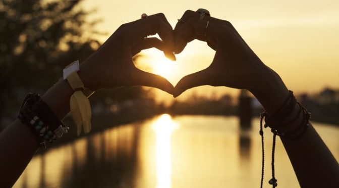 People Making Hands in Heart Shape Silhouette Sunset